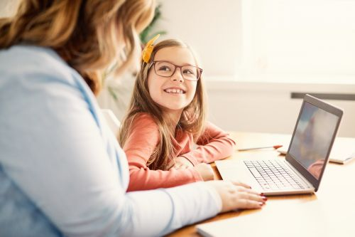 Mother and daughter on a laptop at home