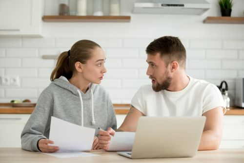 Young couple arguing while working on the computer