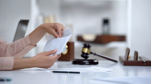 Divorced woman holding envelope with alimony