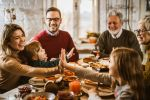 Happy multi-generation family having lunch at dining table